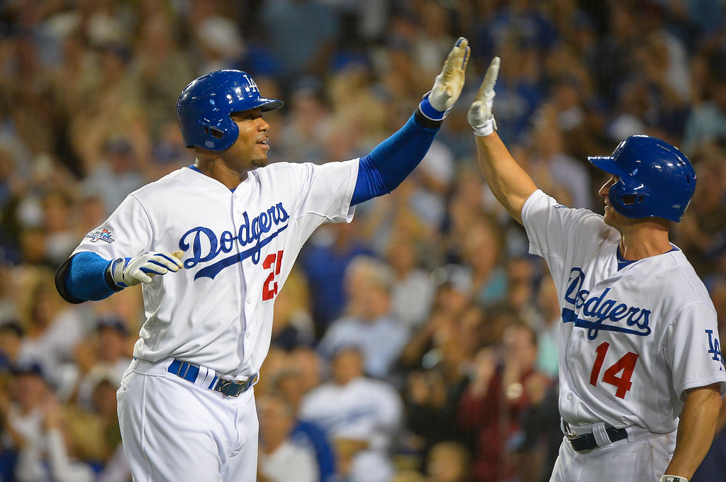 . Dodgers\' Carl Crawford is congratulated by Mark Ellis after hitting his second home run against Atlanta during game action Monday, October 7, 2013 ( Photo by Andy Holzman/Los Angeles Daily News )