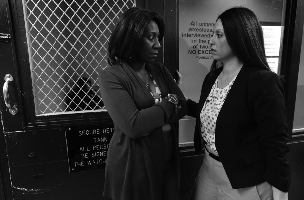 """. (l-r) Mary Magdalene Project Executive Director Stephany Powell and Los Angeles City Councilwoman Nury Martinez talk outside a cell at the Foothill Station. LAPD Police Officers from the Foothill Station participated in a sting operation with a female decoy officer portraying a prostitute. \""""Johns\"""" who approached the decoy and offered to pay for sex were arrested. Sun Valley, CA. 3/6/2014(Photo by John McCoy / Los Angeles Daily News)"""