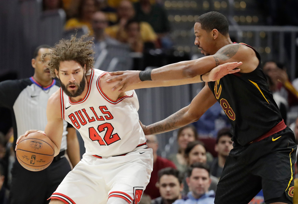 . Chicago Bulls\' Robin Lopez (42) drives against Cleveland Cavaliers\' Channing Frye (8) during the first half of an NBA basketball game Thursday, Dec. 21, 2017, in Cleveland. (AP Photo/Tony Dejak)