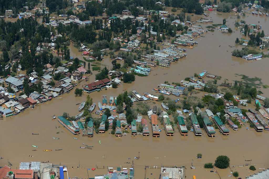 . Kashmiri houseboats and houses submerged by floodwater are seen from an Indian Air Force helicopter during rescue and relief operations in Dal Lake in Srinagar on September 10, 2014.   AFP PHOTO/Tauseef MUSTAFA/AFP/Getty Images