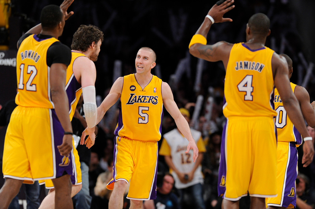 . Lakers#5 Steve Blake is congratulated for a go-ahead 3 pointer late in the 4th quarter. The Lakers defeated the Houston Rockets in overtime 99-95 in the final home game of the year at Staples Center in Los Angeles, CA 4/17/2013(John McCoy/Staff Photographer
