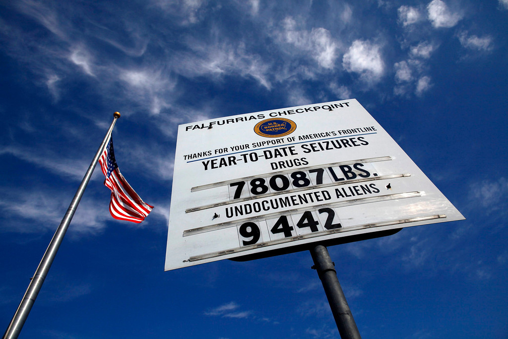 ". A sign is seen at the Falfurrias U.S. Border Patrol checkpoint near Falfurrias, Texas March 29, 2013. Brooks County has become an epicentre for illegal immigrant deaths in Texas. In 2012, sheriff\'s deputies found 129 bodies there, six times the number recorded in 2010. Most of those who died succumbed to the punishing heat and rough terrain that comprise the ranch lands of south Texas. Many migrants spend a few days in a ""stash house\"", such as the Casa del Migrante, in Reynosa, Mexico, and many are ignorant of the treacherous journey ahead. Picture taken March 29, 2013. REUTERS/Eric Thayer"