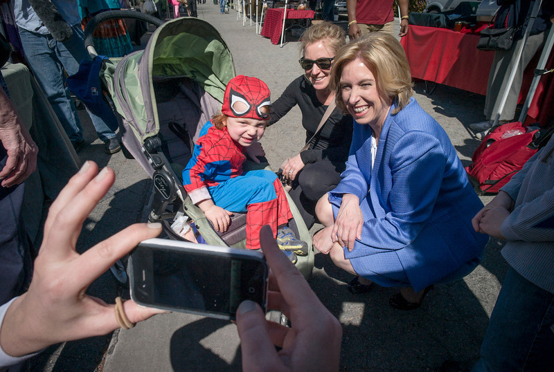 . Wendy Greuel, right, poses for photos with Jana Shenfeld and her son Wyatt, 3, while on campaign stop at the Encino Farmers Market Sunday.  Greuel is running for Los Angeles mayor.  The election is Tuesday.   Photo by David Crane/Staff Photographer