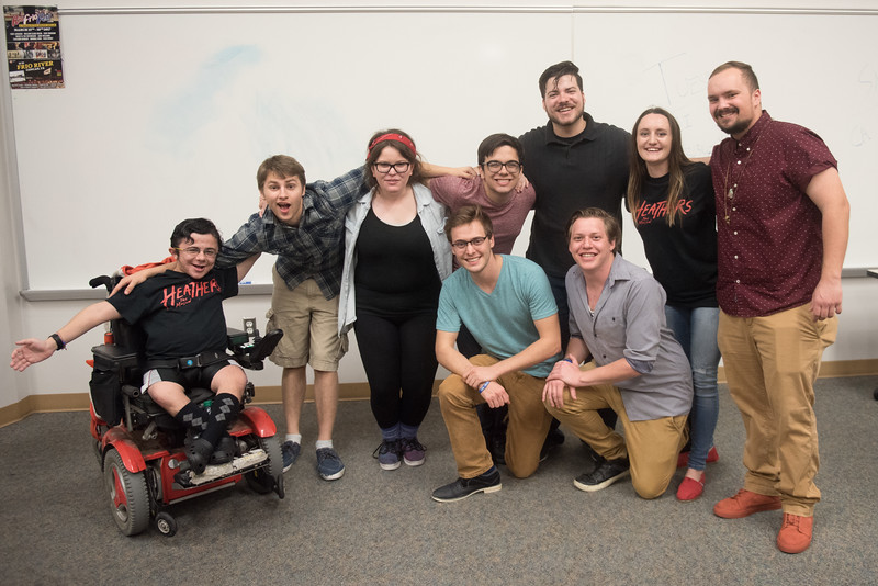Students taking part in Islander Improv come together for a group photo.
