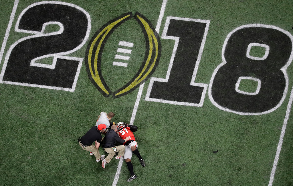 . Georgia\'s David Marshall is hurt during the first half of the NCAA college football playoff championship game against Alabama Monday, Jan. 8, 2018, in Atlanta. (AP Photo/John Bazemore)