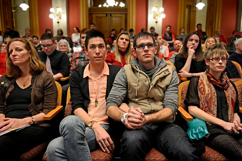 . Marvin Garcia IV, 20, holds hands with his partner, Kendall B. Rice, 22, as they listen to testimony in front of the Senate Judiciary Committee on Senate Bill 11 at the Colorado Capitol on Jan. 23, 2013. The couple have been together for almost two years and would form a civil union if the bill passes.