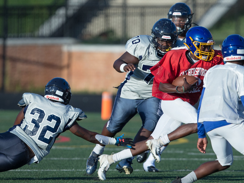 August 29, 2019 - Gaithersburg Quarterback Jacques Mbengang Jr. finds some running room in the Magruder defense during their pre-season scrimmaage. Photo by Mike Clark/The Montgomery Sentinel