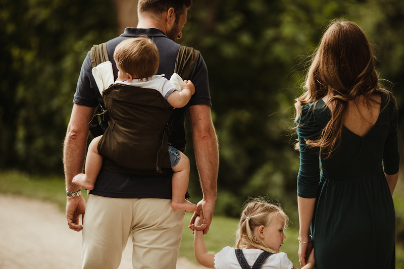 Izmi_Baby_Carrier_Olive_Lifestyle_Back_Carry_Family_Walk_Close_Up.jpg