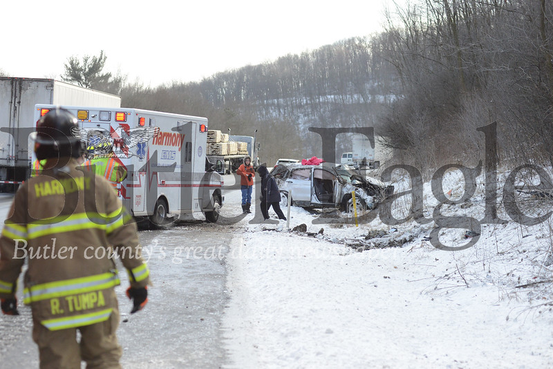Photo by J.W. Johnson Jr.Crews with the Harmony Volunteer Fire Company respond to a rollover accident Monday on Interstate 79 in Lancaster Twp.