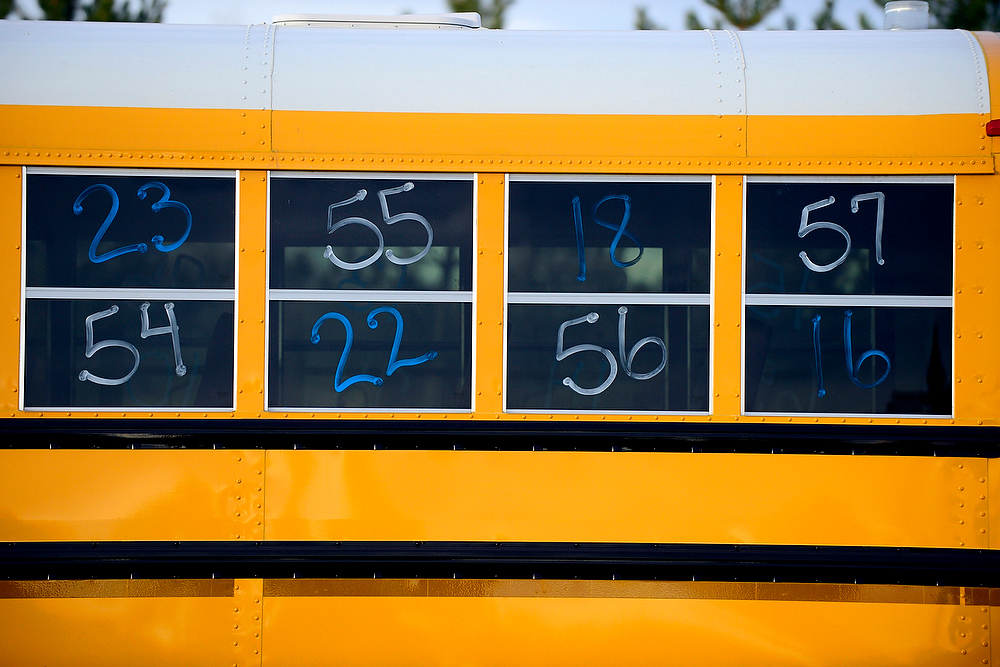 . Trey Johnson\'s number 22 is painted alongside those of his teammates on the windows of their bus as it\'s parked outside of their state title game against Kent Denver. AAron Ontiveroz, The Denver Post