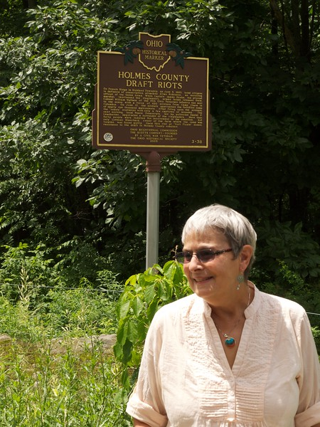 Lesley at the Ohio historical marker for the Holmes County Draft Riots, quelled by Col. William Wallace.