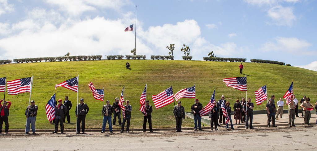 . Members of the Patriot Guard Riders hold American flags at the interment of Sgt. 1st Class Joseph Steinberg at Golden Gate National Cemetery in San Bruno, Calif., on Aug. 1, 2013. (John Green/Bay Area News Group)