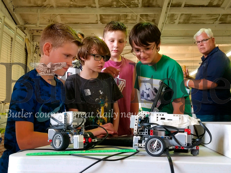 Children in the 4-H Robotics club showed off their skills Wednesday night at the Butler Farm Show. Photo by Nathan Bottiger.