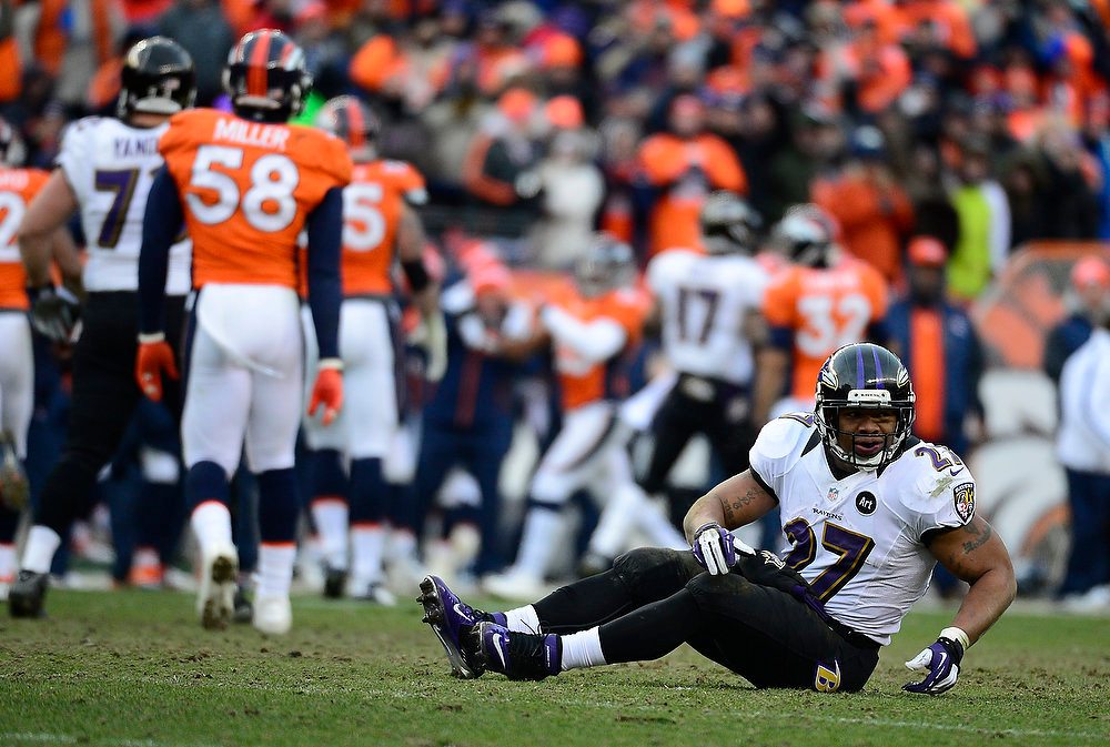 Description of . Baltimore Ravens running back Ray Rice (27) is slow to get up in the second quarter. The Denver Broncos vs Baltimore Ravens AFC Divisional playoff game at Sports Authority Field Saturday January 12, 2013. (Photo by AAron  Ontiveroz,/The Denver Post)