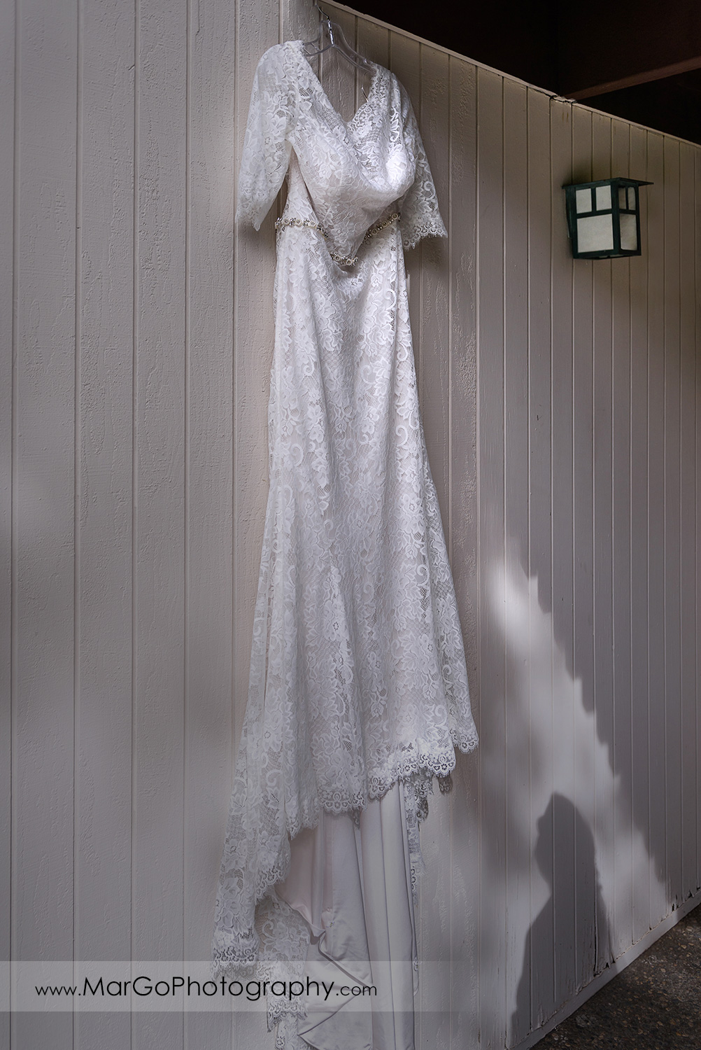 wedding dress hanging on the white wall at Los Gatos Lodge