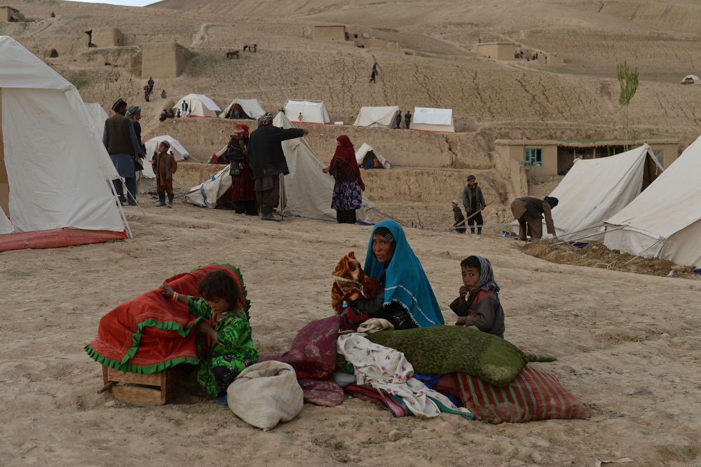 . Afghan villagers sit near relief tents at the scene in Argo district of Badakhshan province on May 3, 2014 after a massive landslide May 2 buried a village. Rescue teams abandoned the search for survivors May 3 after a landslide buried a hillside village in northern Afghanistan, killing at least 300 people under a fast-moving tide of rock and mud. (SHAH MARAI/AFP/Getty Images)