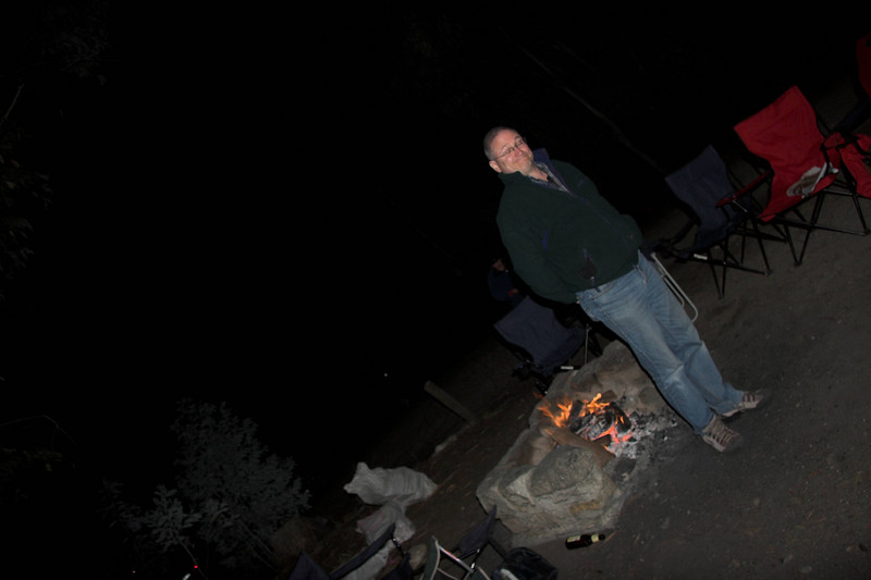 Whilst everybody else eats cake, Phil realises he can get a good spot by the fire.