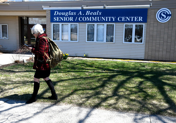 4/20/2018 Mike Orazzi | Staff Helen Ayer Patton while on her way into the Bristol Senior Center with a to return Herman James Perry's World War II backpack to family members.