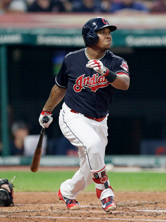 . Cleveland Indians\' Jose Ramirez watches his RBI double off Kansas City Royals Burch Smith in the second inning of a baseball game, Tuesday, Sept. 4, 2018, in Cleveland. (AP Photo/Tony Dejak)