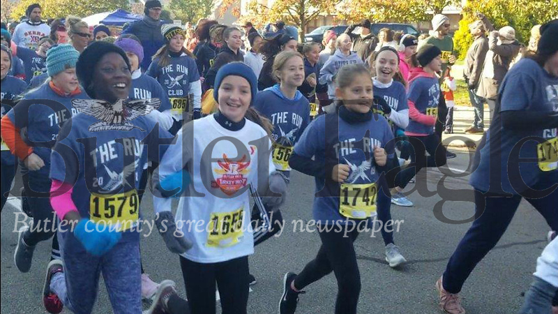 Jim Smith photoRunners take off Saturday morning in the 38th Annual Butler YMCA Turkey Trot in Butler. The event — a 5K race and a one-mile kids run — attracted about 350 runners despite freezing temperatures. 3 col pic