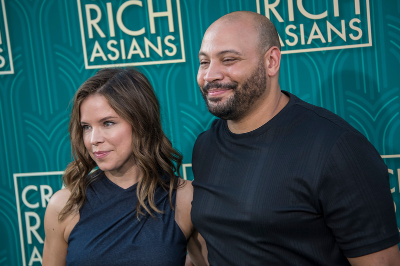 HOLLYWOOD, CA - AUGUST 07: Jessica Stier and Colton Dunn arrive at Warner Bros. Pictures' 'Crazy Rich Asians' Premiere at TCL Chinese Theatre IMAX on Tuesday, August 7, 2018 in Hollywood, California. (Photo by Tom Sorensen/Moovieboy Pictures)