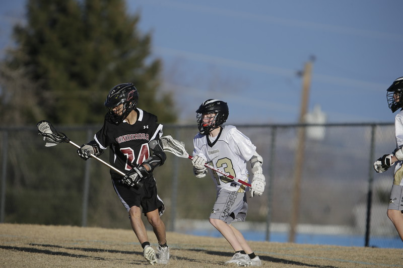 JPM0203-JPM0203-Jonathan first HS lacrosse game March 9th.jpg