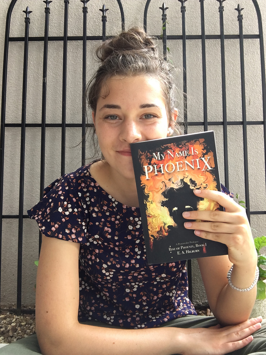 "Erin Hilburn holds a copy of her novel, ""My Name Is Phoenix"""