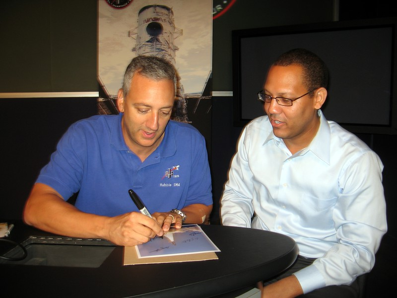 STS-125 Mission Specialist 4 Mike Massimino autographs a photo Darron took of the launch