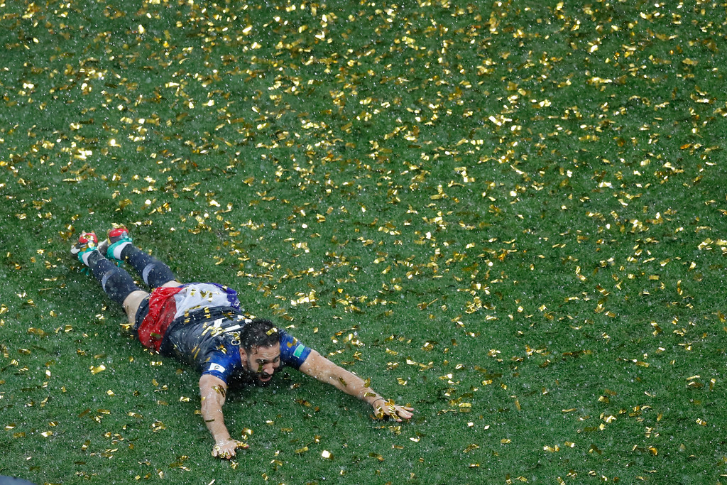 . France\'s Adil Rami celebrates at the end of the final match between France and Croatia at the 2018 soccer World Cup in the Luzhniki Stadium in Moscow, Russia, Sunday, July 15, 2018. (AP Photo/Rebecca Blackwell)