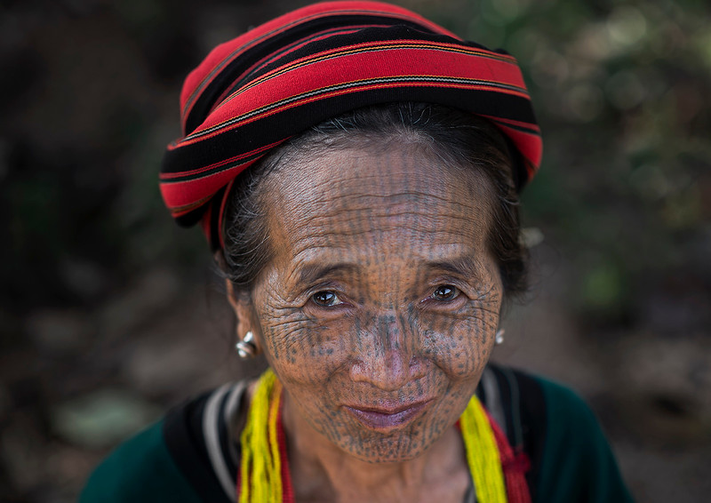 tribal woman with face tattoo.  Chin State, Myanmar, 2017