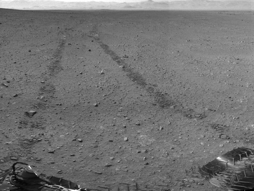 . FILE - This image provided by NASA/JPL-Caltech shows the surroundings of the location where NASA Mars rover Curiosity arrived on Sept. 4, 2012. It is a mosaic of images taken by Curiosity\'s Navigation Camera (Navcam) following the Sol 29 drive of 100 feet. About 9 feet apart, tracks from the drive are visible in the image. (AP Photo/NASA/JPL-Caltech)