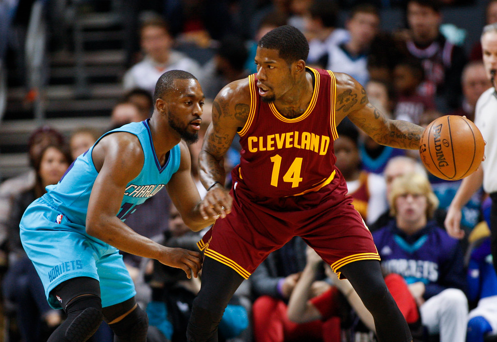 . Cleveland Cavaliers guard DeAndre Liggins, right, looks to pass around Charlotte Hornets guard Kemba Walker during the first half of an NBA basketball game in Charlotte, N.C., Saturday, Dec. 31, 2016. (AP Photo/Nell Redmond)