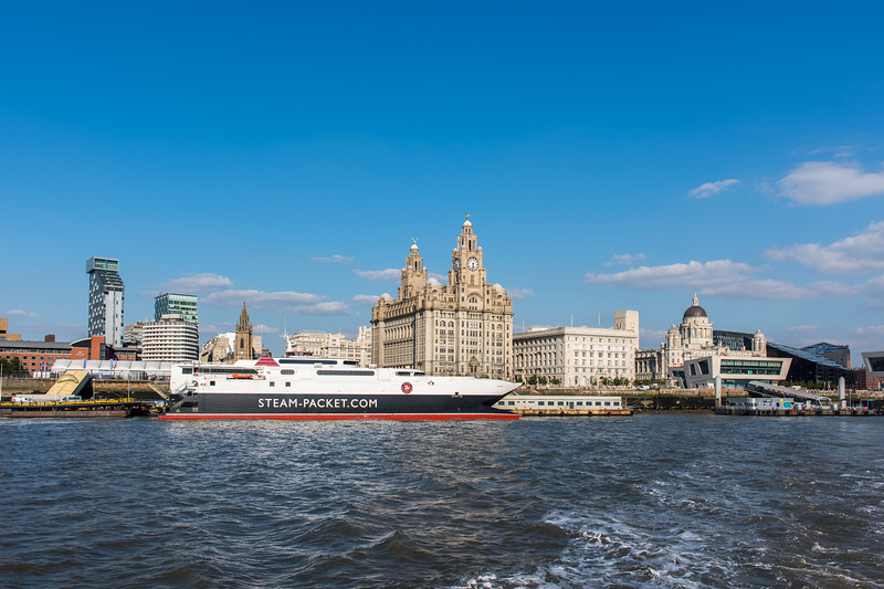 Views of the Three Graces - Royal Liver Building, Cunard Building and Port of Liverpool Building. The Mersey Ferry ticket office can also be seen.