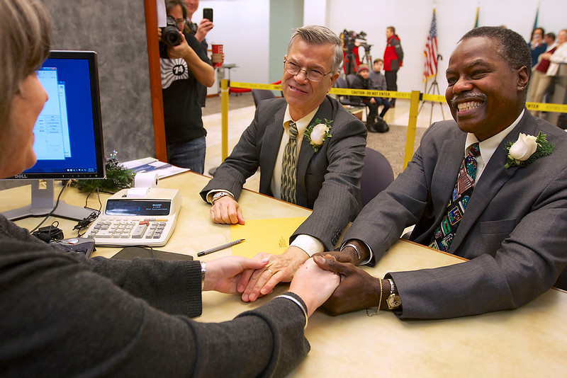 . James Griener, left, and Paul Harris thank clerk June Gaylord after they were the first couple in Clark County to get a marriage license Thursday, Dec. 6, 2012 in Vancouver, Wash. Harris is a manager in the records department and arranged that the pair, who have been together for 39 years, could be first to get the paper work that will allow them to marry anytime after a 3-day waiting period.  Washington state now joins several other states that allow gay and lesbian couples to wed. Gov. Chris Gregoire signed a voter-approved law legalizing gay marriage. Because the state has a three-day waiting period, the earliest that weddings can take place is Sunday.  (AP Photo/The Oregonian, Randy L. Rasmussen)