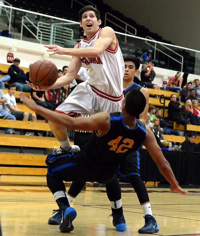 . Glendora\'s Thomas Rico (C) (5) in the first half of a prep basketball game during the SoCal Shootout in the Felix Event Center on the west campus of Azusa Pacific University in Azusa, Calif., on Saturday, Jan. 18, 2014. (Keith Birmingham Pasadena Star-News)