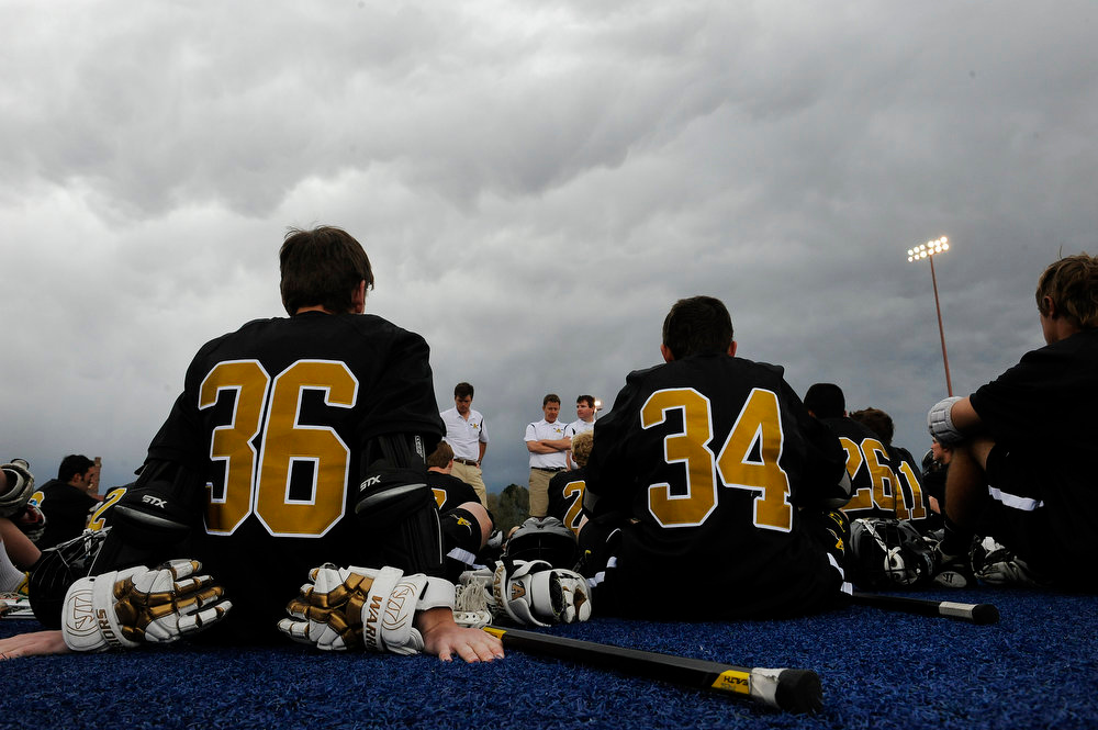 . Arapahoe High School freshman midfielder Grant Evans #36 sits with freshman midfielder Sam Cofield #34 during halftime against Regis Jesuit during a CHSAA 5A boys lacrosse semifinal game at All City Stadium on May 15, 2013, in Denver, Colorado. Arapahoe won 13-5 to advance to the finals. (Photo by Daniel Petty/The Denver Post)