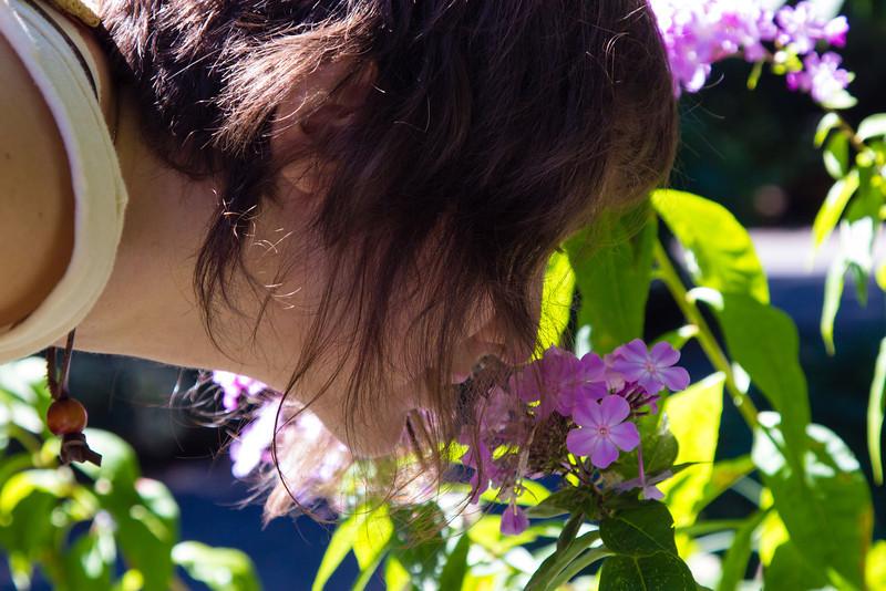 Felicity smells a flower