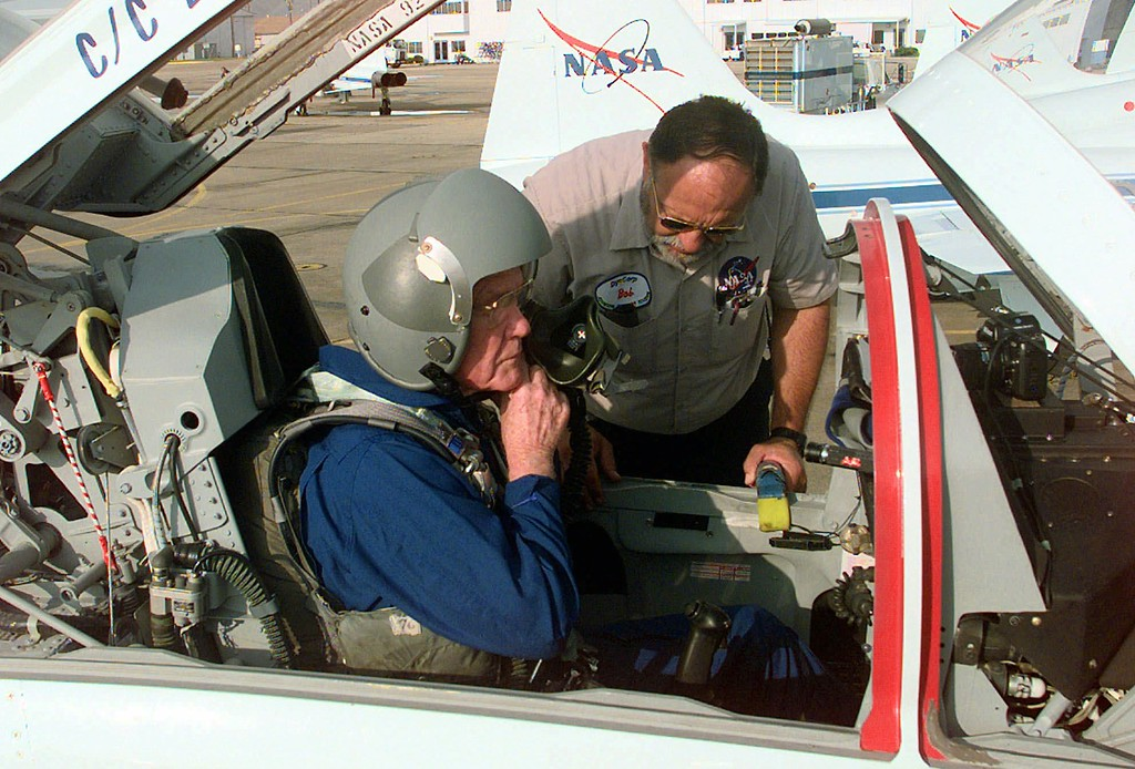 . Astronaut and Sen. John Glenn, D-Ohio, left, receives help from Bob Mullen, flight line crew leader, as he prepares for a training flight Monday, Aug. 24, 1998, in Houston. Glenn, 77, is scheduled to fly on a space shuttle mission in October. (AP Photo/David J. Phillip)