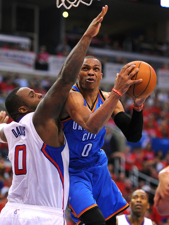 . The Thunder\'s Russell Westbrook drives to the basket against the Clippers\' Glen Davis, Thursday, May 15, 2014, at Staples Center. (Photo by Michael Owen Baker/Los Angeles Daily News)
