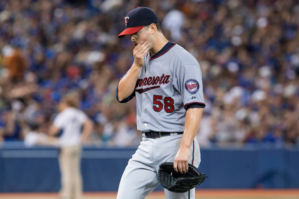 . Twins starter Scott Diamond reacts as he is pulled after giving up four runs to the Jays during the fifth inning. Diamond\'s line: six earned runs on eight hits, including three home runs, over 4-2/3 innings. (AP Photo/The Canadian Press, Chris Young)