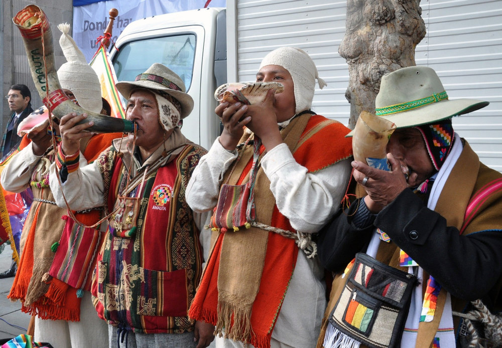 ". Handout photo released by the Bolivian Presidency of Aymara indigenous people playing the ""pututu\"" during celebrations for the third anniversary of the Plurinational State of Bolivia outside Quemado palace in La Paz, on January 22, 2013. PresidenciaHO/AFP/Getty Images"
