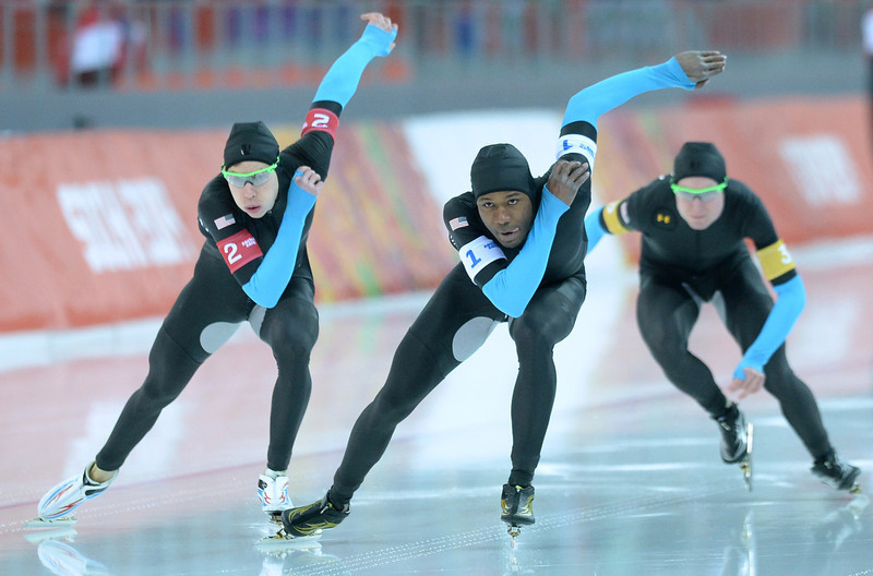 . US Shani Davis (C), Brian Hansen (L) and Jonathan Kuck compete in the Men\'s Speed Skating Team Pursuit Quarterfinals at the Adler Arena during the Sochi Winter Olympics on February 21, 2014. (JUNG YEON-JE/AFP/Getty Images)