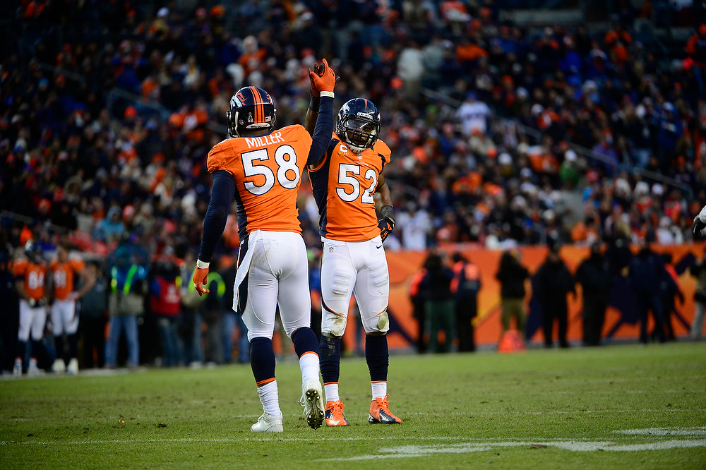 Description of . Denver Broncos outside linebacker Von Miller (58) celebrates with Denver Broncos outside linebacker Wesley Woodyard (52) after a sack in the fourth quarter as the Denver Broncos took on the Kansas City Chiefs at Sports Authority Field at Mile High in Denver, Colorado on December 30, 2012. AAron Ontiveroz, The Denver Post