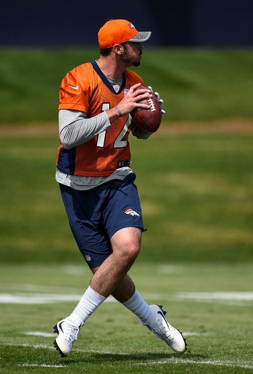 . Denver Broncos quarterback Paxton Lynch (12) drops back to pass during rookie minicamp May 6, 2016 at UCHealth Training Facility. (Photo By John Leyba/The Denver Post)
