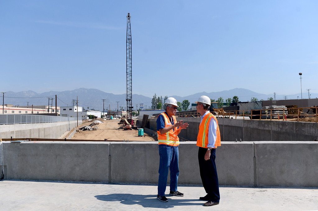 . Mark Christoffels, right, CEO and chief engineer of ACE, speaks with an official on the newly built railroad bridge on the northern half of the grade separation at Baldwin Avenue and Gidley Street in El Monte Friday, May 16, 2014. The 2-year project, which closed Baldwin Avenue, is one of 22 underpasses from Los Angeles to Pomona that are done or expected to be completed by 2019. Baldwin Avenue is halfway complete. (Photo by Sarah Reingewirtz/Pasadena Star-News)