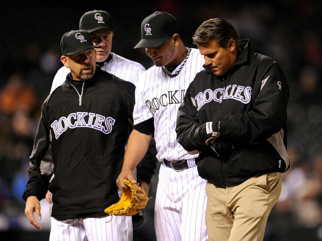 . DENVER, CO. - APRIL 19:  Manager Walt Weiss talked with starter Joulhys Chacin as he walked off the mound in the seventh inning. The Colorado Rockies defeated the Arizona Diamondbacks 3-1 at Coors Field Friday night, April 19, 2013.  Photo By Karl Gehring/The Denver Post)
