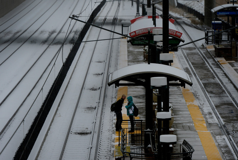 . Commuters wait for a train at the light rail station in downtown in Littleton, CO April 09, 2013. A winter storm has blown into northeastern Colorado, with strong winds and below-freezing temperatures creating blizzard-like conditions at times. (Photo By Craig F. Walker/The Denver Post)