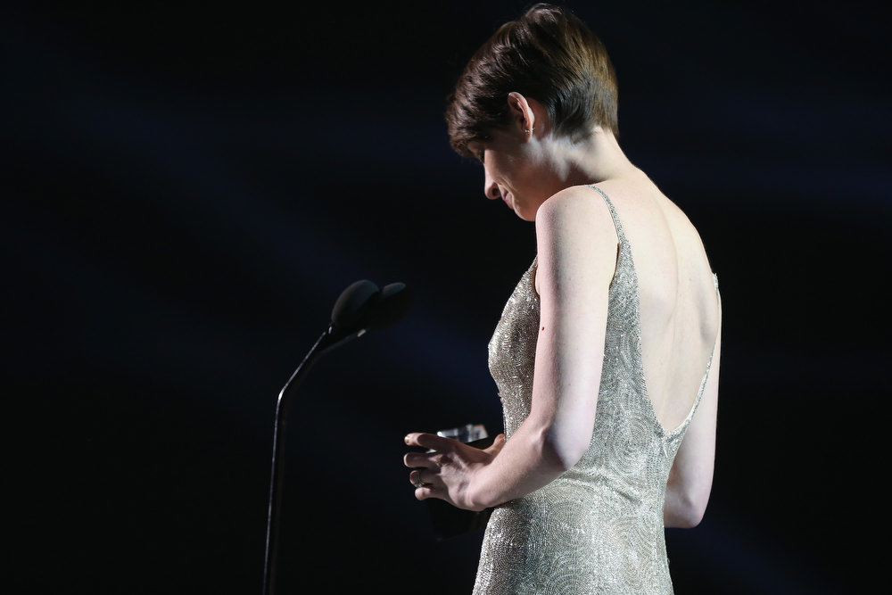 Description of . Actress Anne Hathaway accepts the award for Best Supporting Actress onstage at the 18th Annual Critics' Choice Movie Awards held at Barker Hangar on January 10, 2013 in Santa Monica, California.  (Photo by Christopher Polk/Getty Images for BFCA)
