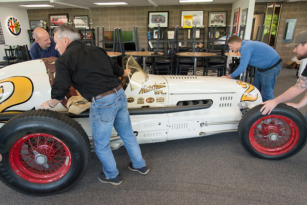 05/15/19 Wesley Bunnell | Staff Michael Donnelly, President of The Paddock Classic Car Restorations, reaches in and steers a custom built race car named the Marchese Special into his showroom at 285 Columbus Blvd on Wednesday afternoon. The race car which was built in the early 1940's competed in the Indianapolis 500 until 1951.