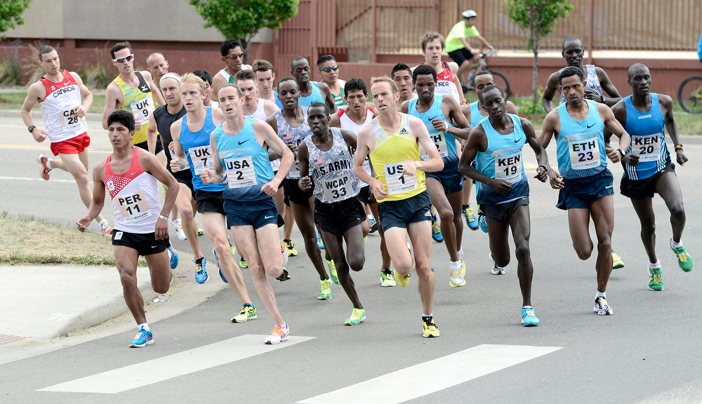 . Men\'s Elite runners stay in a tight pack early in the race during the Bolder Boulder in Boulder, Colorado May 27, 2013. BOULDER DAILY CAMERA/ Mark Leffingwell